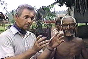 Missionary James Blume interviews an old native man