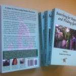 "Four copies (front and back covers) of nonfiction cryptozoology science/religion - ""Searching for Ropens and Finding God"""